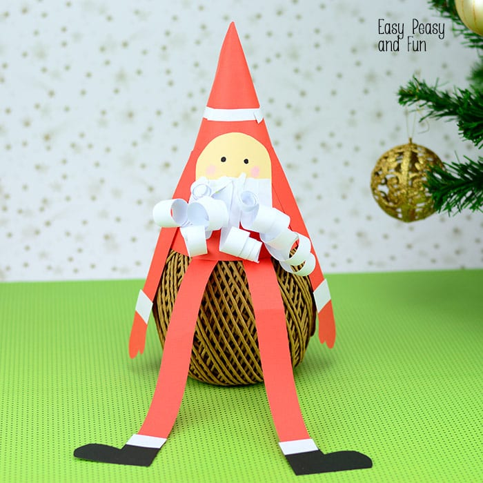 Paper cone santa craft christmas crafts for kids easy for Cardboard cones for crafts