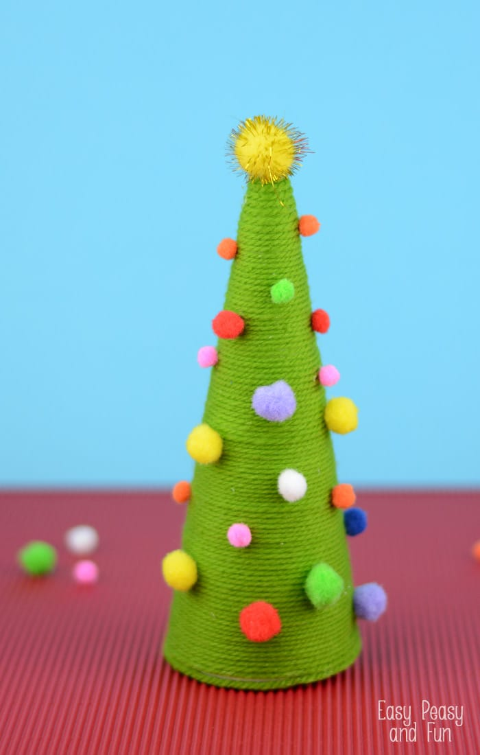 Pom pom cone christmas tree craft easy peasy and fun for Free christmas crafts for kids