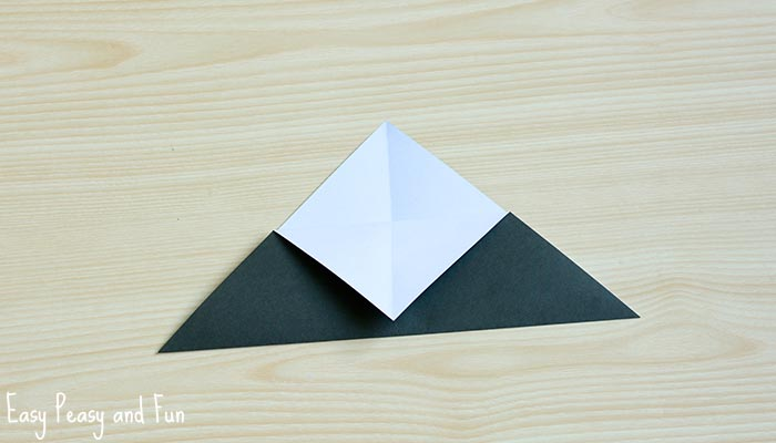 Fold Into A Triangle Colored Side On The Outside Grab Hold Of Top One Sheet Only And It Toward Bottom