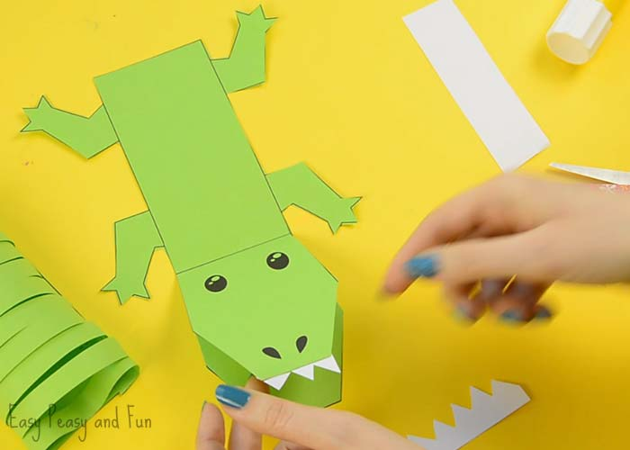 Apply A Good Amount Of Glue On The Body Part With Legs Withing Large Square Take Crocodile Back And Tail Looped