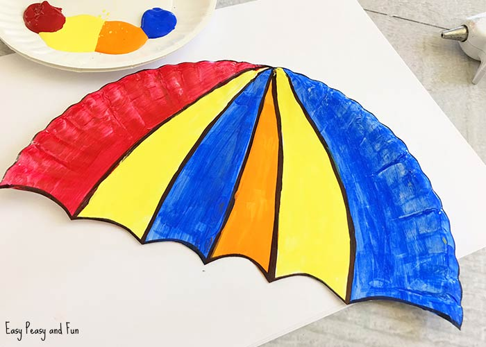 Cut the bottom piece of the plate you set aside into a handle for the umbrella and glue to the back bottom center of the umbrella. & Umbrella Paper Plate Craft - Weather Crafts for Kids - Easy Peasy ...