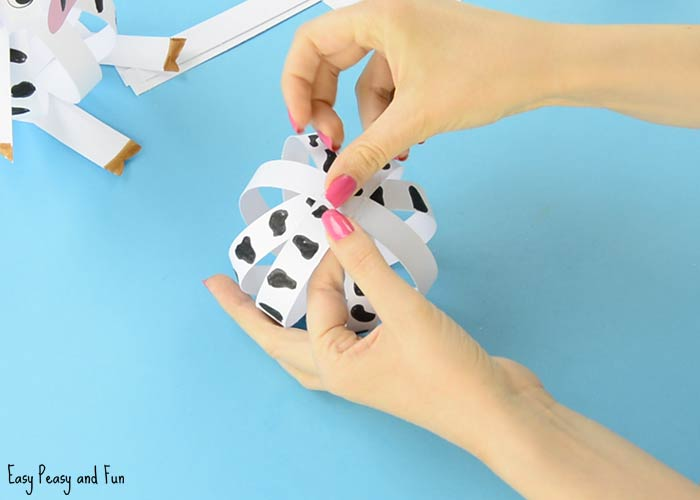 Easy paper cow craft farm animal craft ideas easy peasy and fun repeat the steps with the shorter strips mightylinksfo