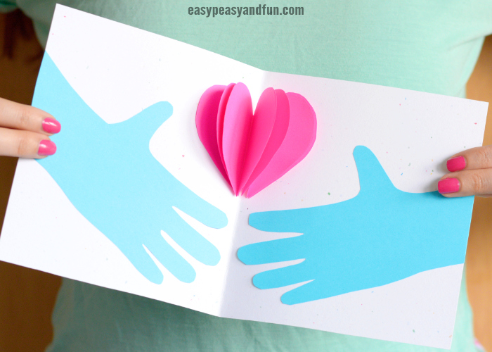 Hands Holding a Heart Mother's day Card