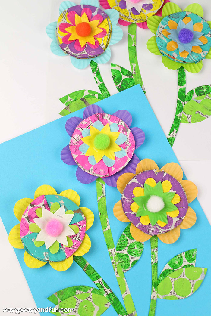 These recycled newspaper flowers are so cool. Such a cool spring kindergarten craft for kids to make.