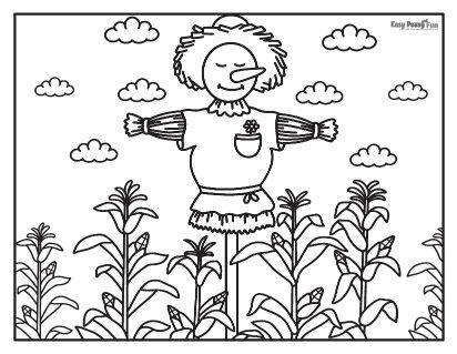 Épouvantail dans le champ de maïs